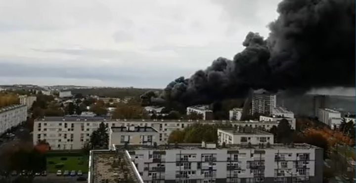 Smoke rises from a burning warehouse Saturday in Le Harve, France. - Screencapture Via Storyful