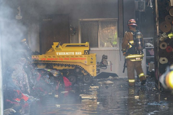 The RS3 firefighting robot pushes aside debris after fire swept through a commerical building Tuesday morning in Los Angeles. - Photo Courtesy of Los Angeles Fire Department