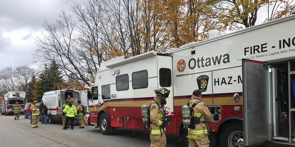Firefighters deploy equipment from the Ottawa Fire Service Hazmat Incident Command vehicle.