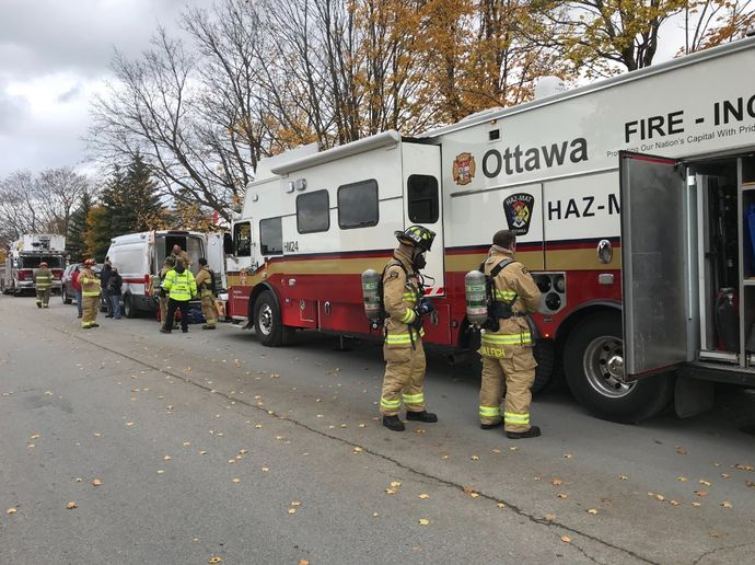 Firefighters deploy equipment from the Ottawa Fire Service Hazmat Incident Command vehicle. - Photo Courtesy of Ottawa Fire Service