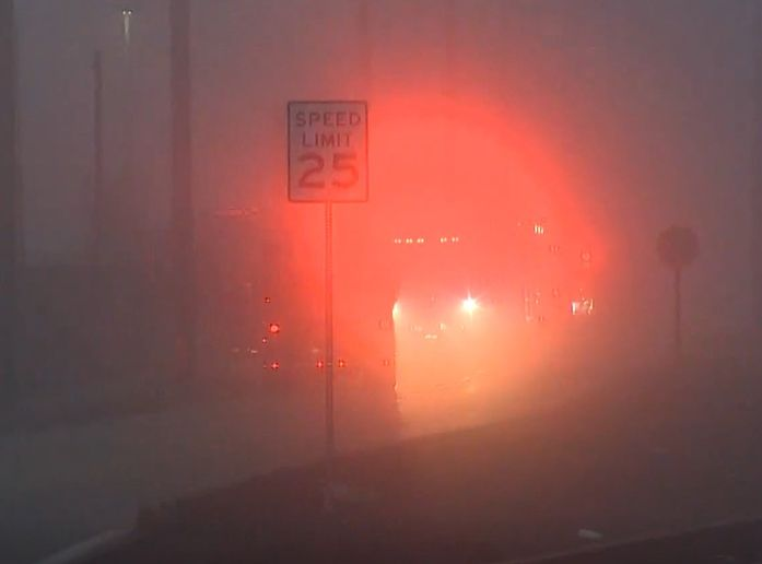 Fog obscures the action on Harbor Island in Seattle, Washington, after a gasoline spill Thursday. - Screencapture Via KING