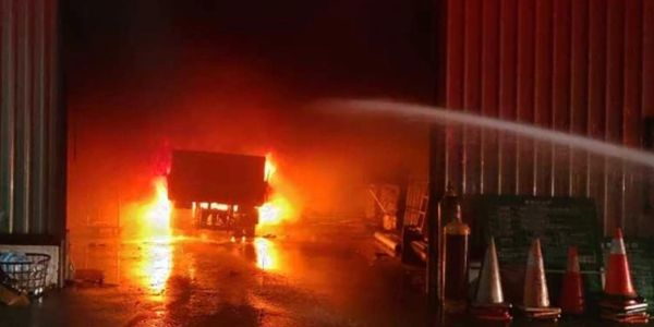 A truck loaded with acetylene cylinders burns inside a Taiwanese factory Friday morning.