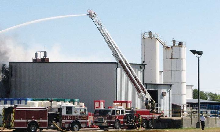 Tower ladder in operation during the Magnablend chemical plant fire in October 2011. - Photo Courtesy of Ennis Fire Department