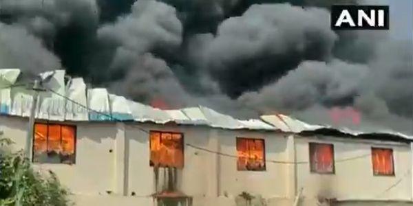 Fire spreads through a plastics manufacturing unit Saturday morning in Valsad, India.