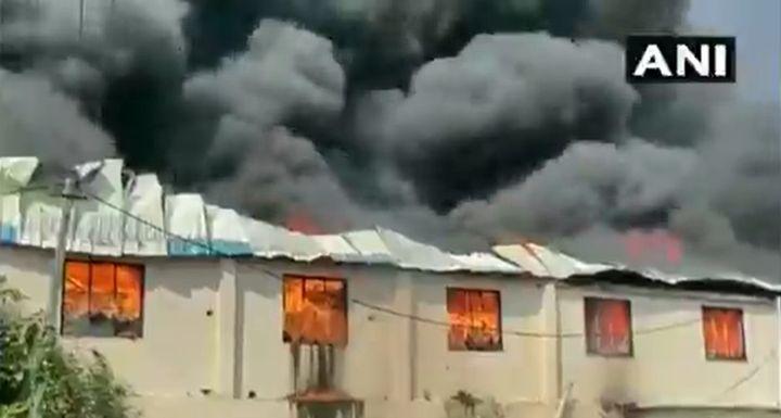 Fire spreads through a plastics manufacturing unit Saturday morning in Valsad, India. - Screencapture Via ANI