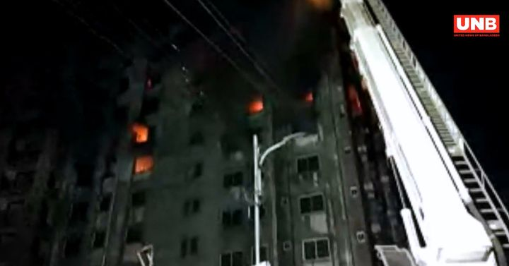 An aerial device is used to hit the fire in the upper floors of a warehouse Thursday in Bangladesh. - Screencapture Via UNB