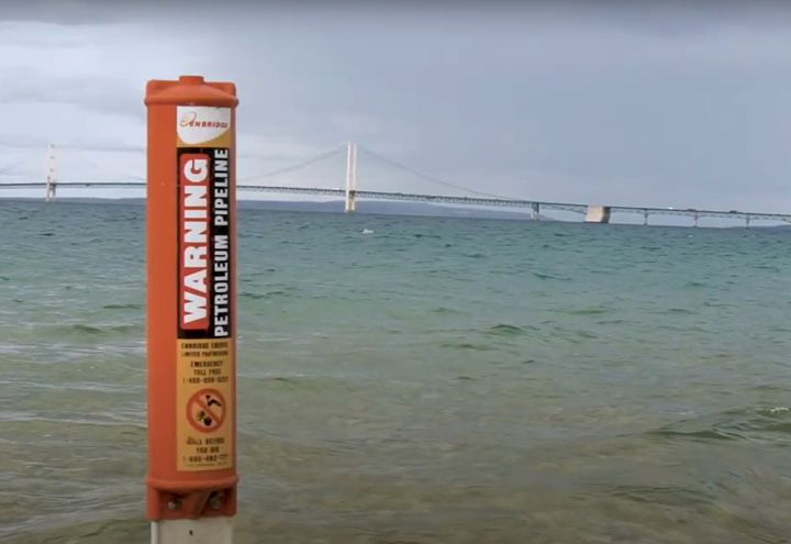 Enbridge pipeline marker on Michigan's Straits of Mackinac. - Screencapture Via Great Lakes Now