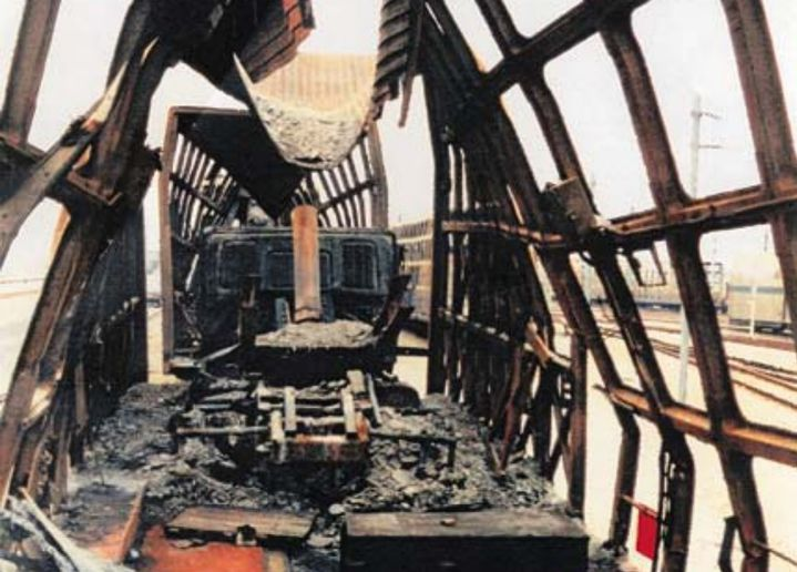 The gutted remains of a rail car hauling tractor-trailer rigs in the aftermath of the Eurotunnel fire. - Photo Courtesy of Channel Tunnel Safety Authority