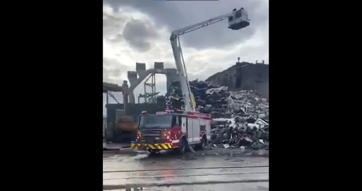 Chicago firefighters respond to a large garbage fire at a metal recycling plant Tuesday. - Screencapture Via Facebook