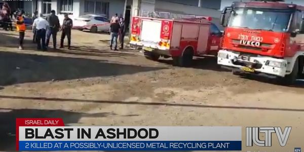 Firefighters on standby at a factory explosion Tuesday in south Israel.