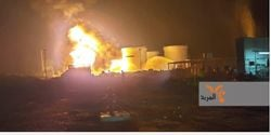 Flames rise from the Siniya refinery in Iraq after a rocket attack by militants Sunday.