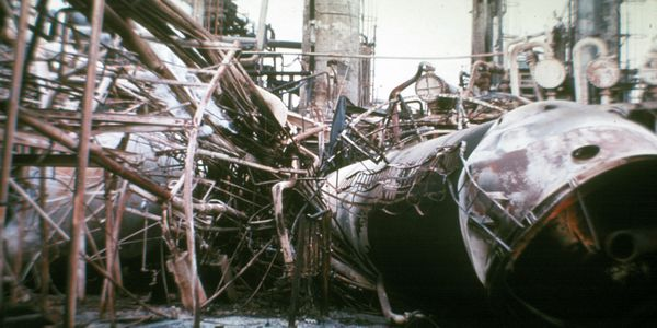 A concrete tower skirt failed to provide adequate fire protection.
