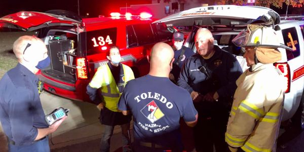 Toledo firefighters meet at the scene of an ongoing hazmat situation Thursday.