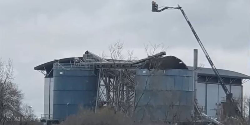 An aerial device is used to observe the damage after an explosion Thursday at a water recycling...