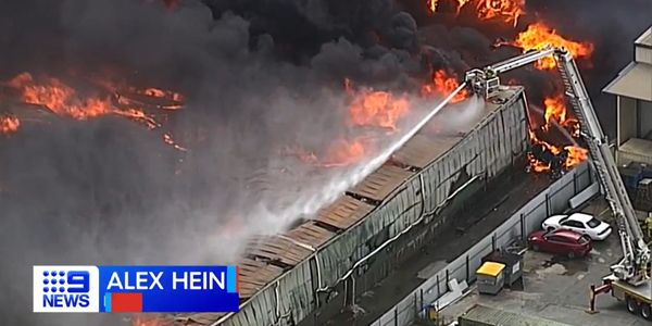 Flames consume a massive recycling facility in Brisbane, Australia.