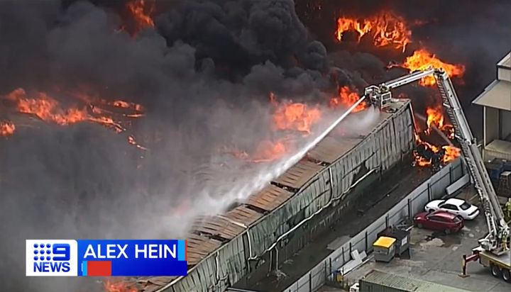 Flames consume a massive recycling facility in Brisbane, Australia. - Screencapture Via Nine News