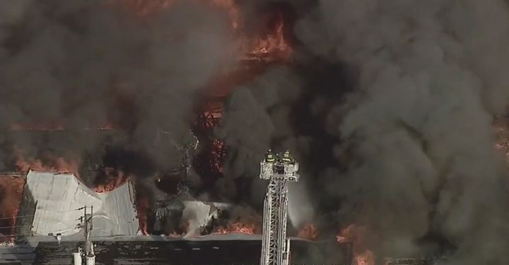Aerial photo capture only a small portion of a warehouse fire burning Wednesday in Chicago. - Screencapture Via WBBM