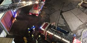 German Firefighters Battle Factory Roof Blaze