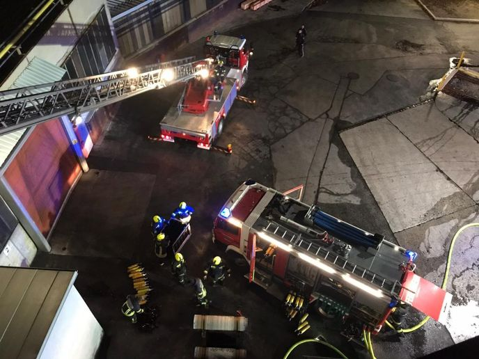 The view from the roof as firefighters battle a fire at a metalworking factory Monday in Germany. - Photo Courtesy of Enzesfeld Fire Brigade