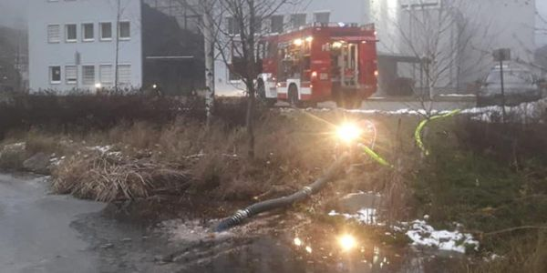 Firefighters in Austria draft water from a frozen pond to extinguish a factory fire Sunday.