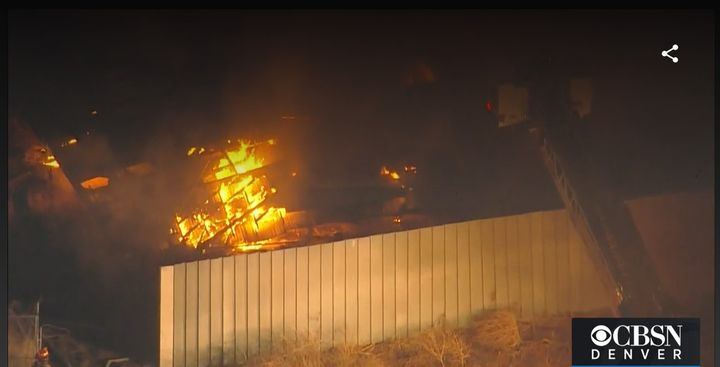 Drone footage captures flames rising inside an abandoned sugar refinery Wednesday in Longmont, Colorado. - Screencapture Via KCNC