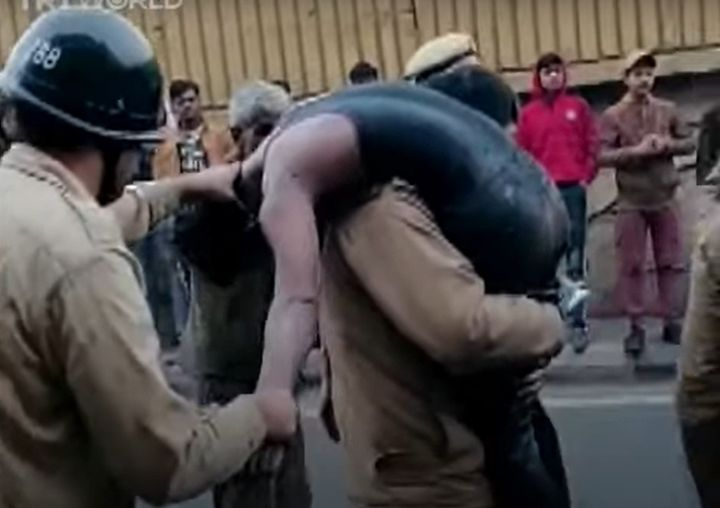 Emergency responders rescue an unconscious worker after fire swept through a factory Wednesday in New Delhi, India. - Screencapture Via TRT News