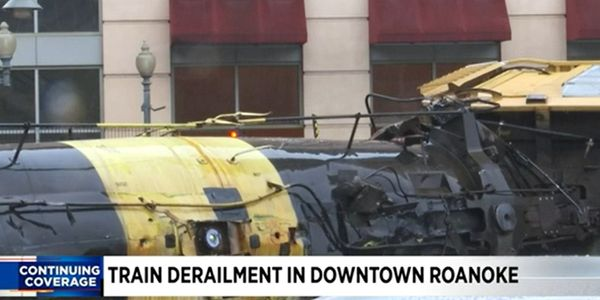 A damaged railroad tank car containing molten sulfur awaits clean up Wednesday in Roanoke, Virginia.