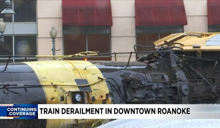 A damaged railroad tank car containing molten sulfur awaits clean up Wednesday in Roanoke, Virginia. - Screencapture ViaWSLS