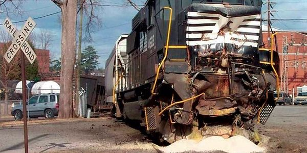 The crumpled front of the moving locomotive in the collision,