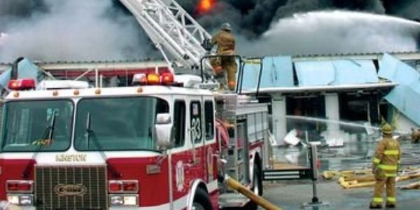 Firefighters swing into action during a rubber components factory fire in January 2003 in...