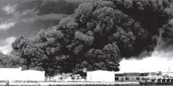 Crude oil boilover spread flameds through a Port Neches, Texas, tank farm in 1974.