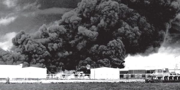 Crude oil boilover spread flameds through a Port Neches, Texas, tank farm in 1974.