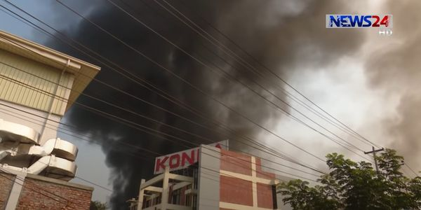 Smokes rises the entire length of the Konka refrigerator factory Sunday in Bangladesh.