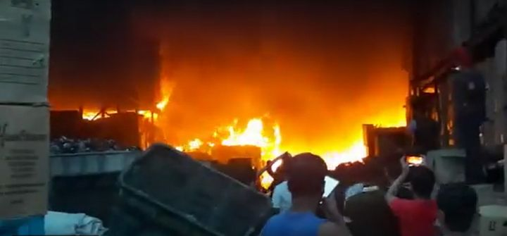 Flames raced through a rubber goods warehouse Saturday in Malaysia. - Screencapture Via Sing Chew People