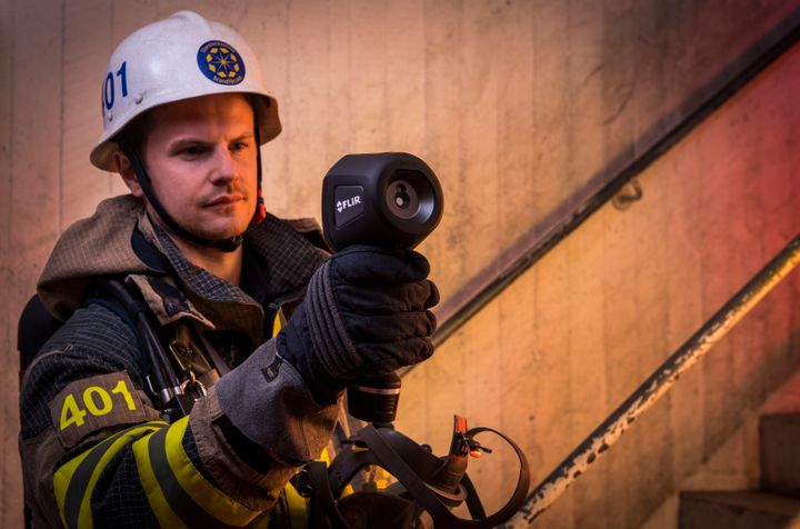 Thermal imagers enable firefighters to peer through smoke and even structures to see what's happening in real time. - FLIR