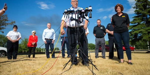 Key personnel representing fire officials, the company and others at a recent press conference...