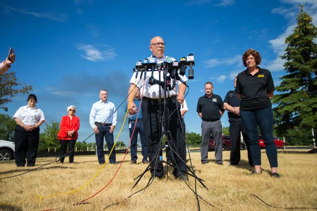 Key personnel representing fire officials, the company and others at a recent press conference involving the Chemtool incident. - Rockford Register Star
