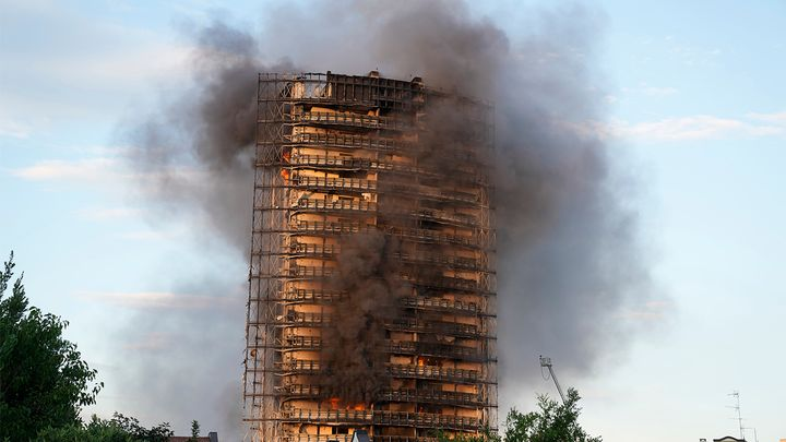 """""""The cause of the fires still needs to be determined, but it seems that the rapid spread of the flames was due to the thermal covering of the building,"""" said Carlo Sibia, an Interior Ministry official in Rome. - AP Photo/Luca Bruno"""