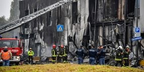 Plane Strikes Milan Office Building