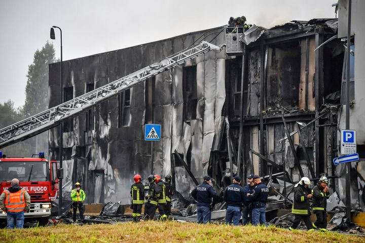 The plane plunged and struck the building's roof. - Claudio Furlan/LaPresse via AP