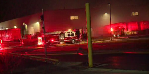 Upon arrival firefighters were met with an industrial building in full evacuation with heavy...