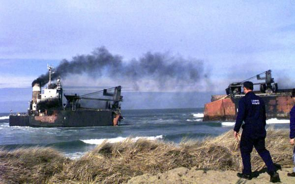 The New Carissa after breaking into two sections during a fire to dispose of its fuel oil cargo.