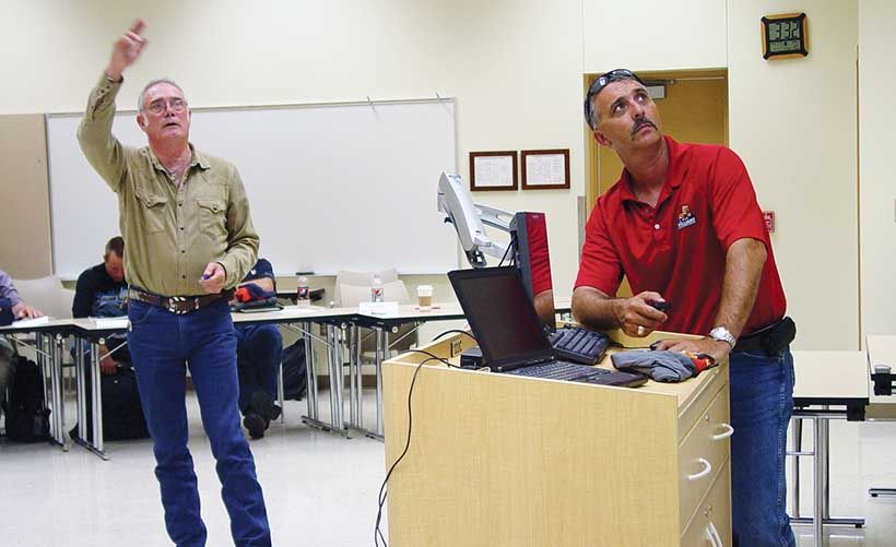 Dwight Williams (left), founder of Williams Fire & Hazard Control, and Herman Ladner deliver a...