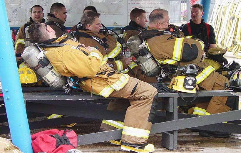Firefighters rest between training evolutions.
