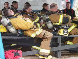 Firefighters rest between training evolutions.