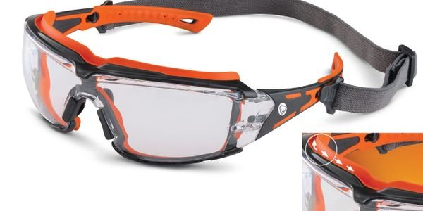 The goggles' rubber gasket seals glasses snugly against the face