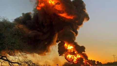 Train Tanker Cars Burst Into Flames After Being Hit By 18-Wheeler