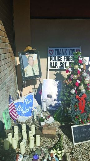 A memorial to Sgt. Ron Helus at the Borderline Bar and Grill.