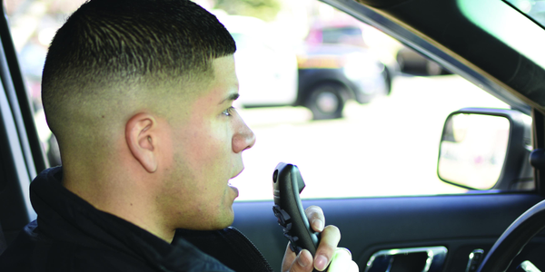 Dragon's speech-powered technology lets officers dictate their reports in real time instead of...