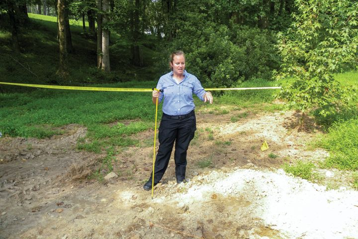 Forensic anthropologist Dr. Meredith Tise from the Pinellas County (FL) Sheriff's Office demonstrated how investigators use a metal probe to examine loose ground at a suspicious grave site.  - Photo: David Griffith